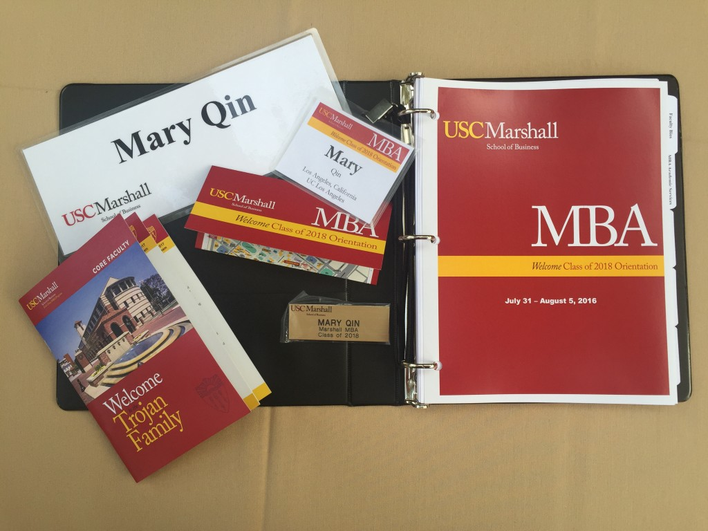 usc marshall mba orientation folder with name tags, schedules, and other documents