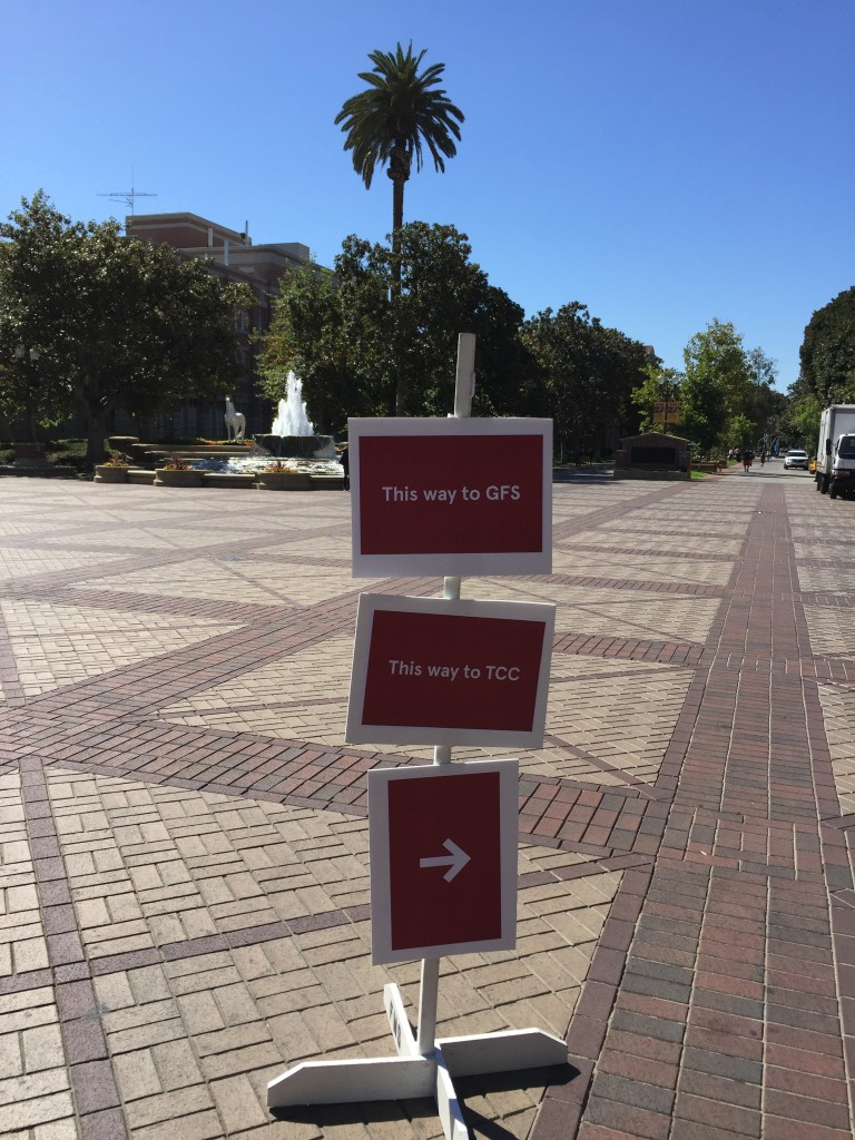 sign post guiding attendees to breakout rooms for usc own it 2016 conference
