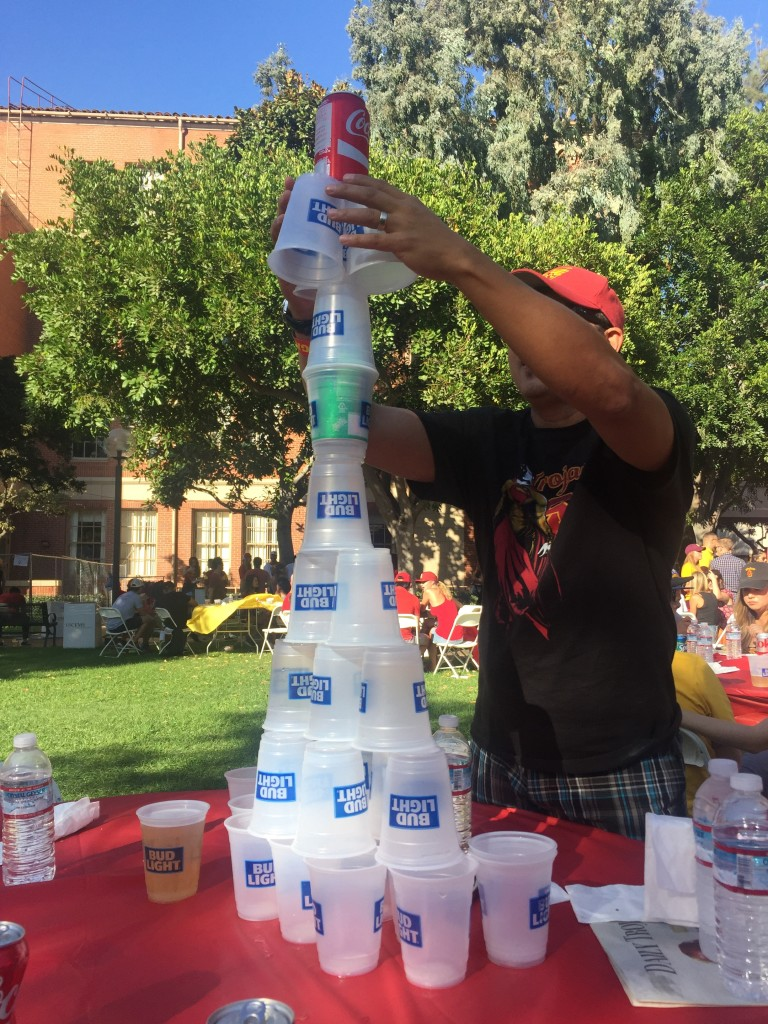 building plastic cup tower at tailgate party