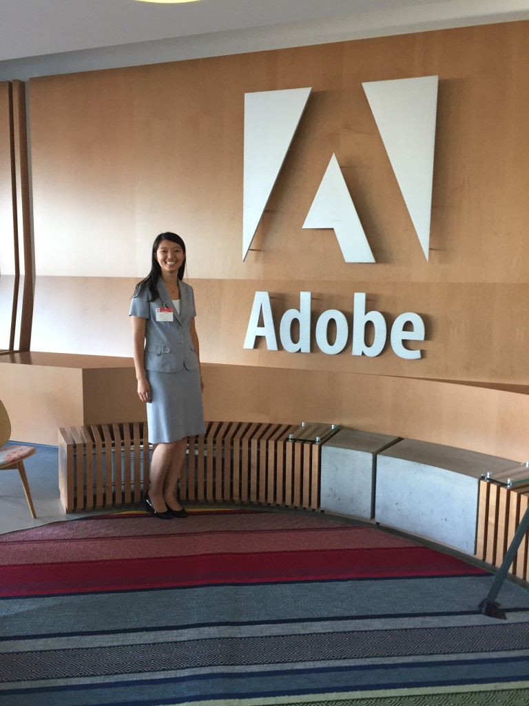 posing by entry of adobe headquarters