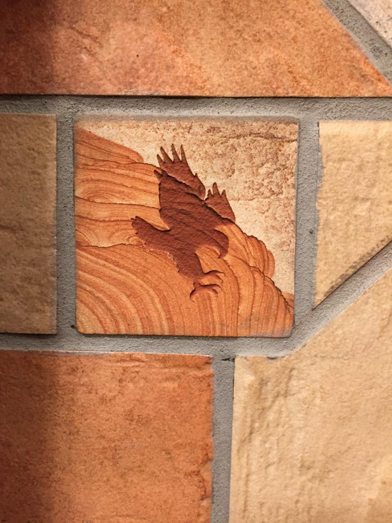 eagle decoration carved in stone tile of bathroom