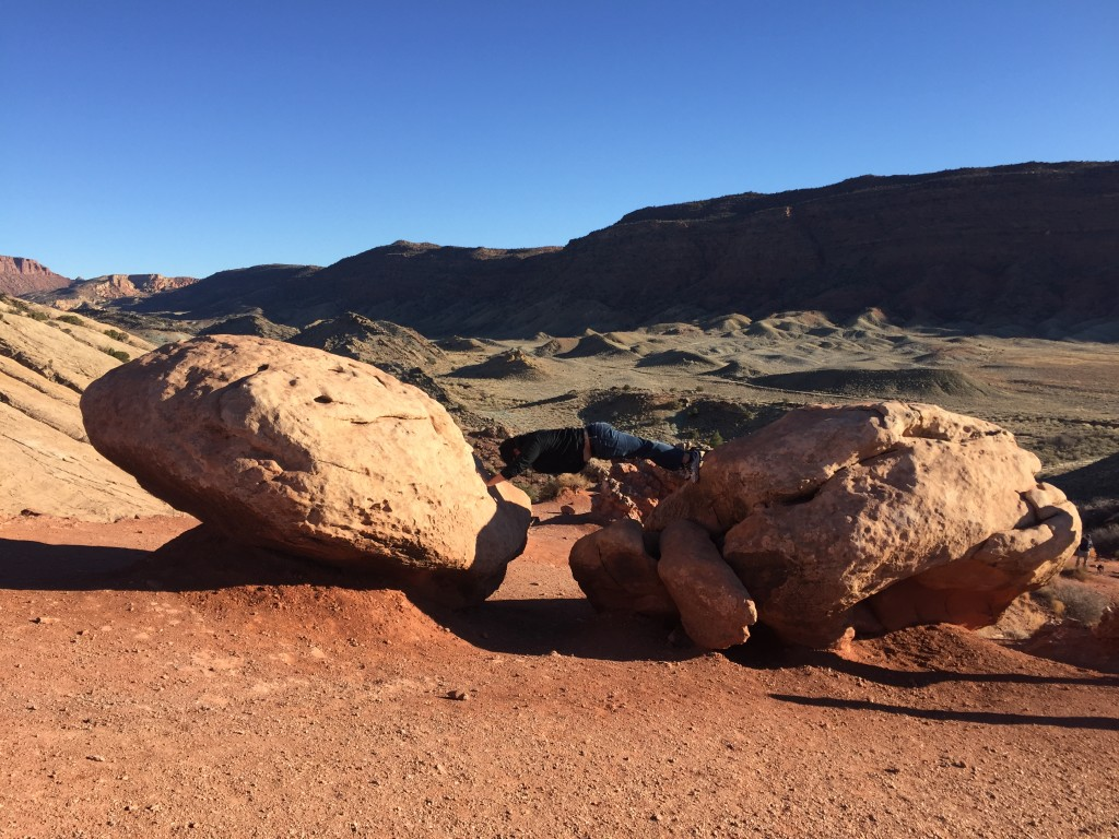 planking across boulders to create manmade arch