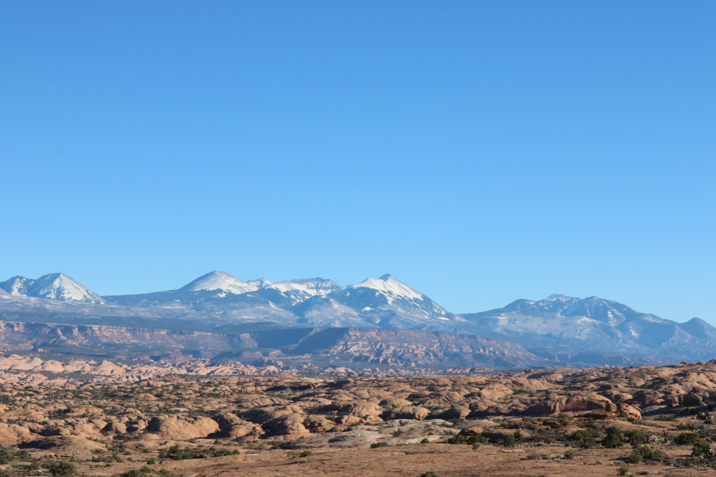 snowy mountains against red rocks