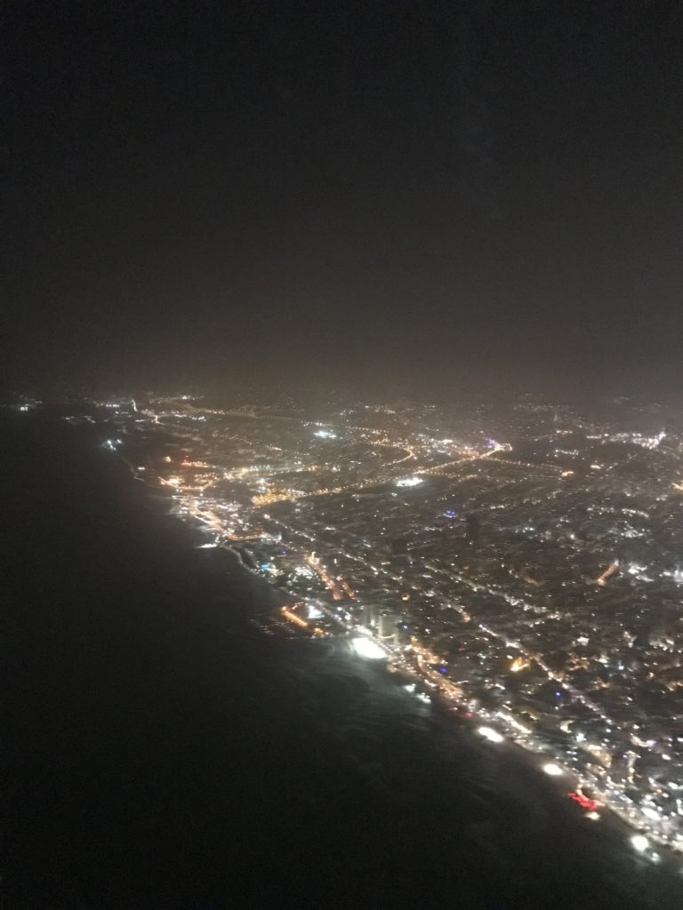 view of tel aviv coast from plane at night