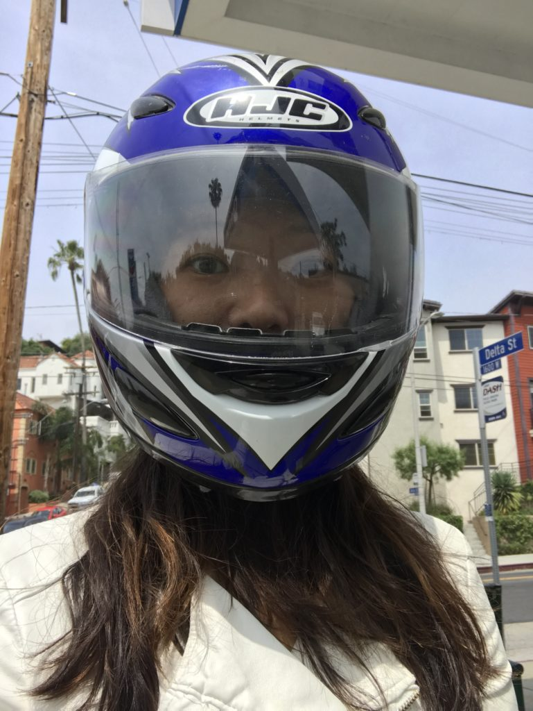 selfie with blue motorcycle helmet on