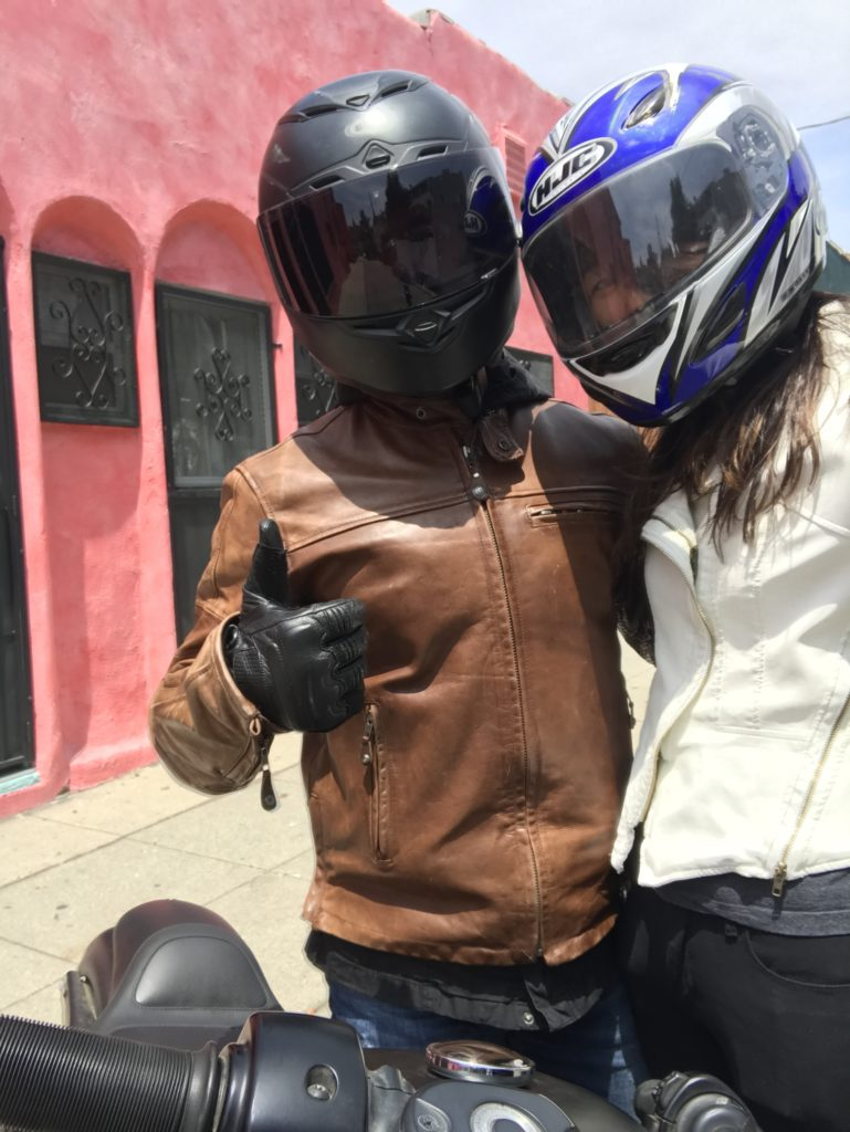 motorcycle riders with leather jackets and helmets