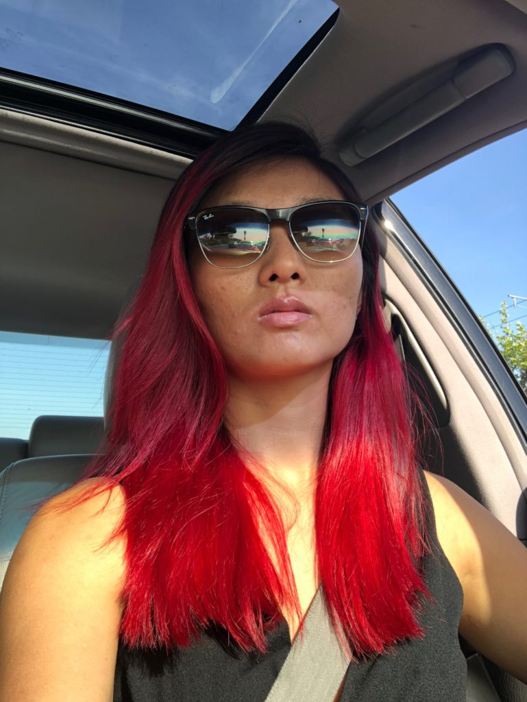bright red hair car selfie